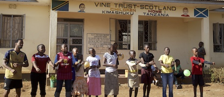 People singing outside Kimashuku children's home, Tanzania